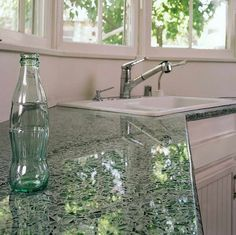 recycled glass countertop by Vetrazzo, color is Hollywood Sage, made from old Coca-Cola bottles.
