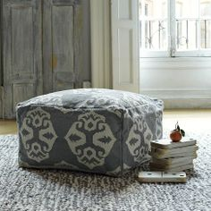 The dhurrie fabric and woven pattern lend an old-world, global flair to this versatile pouf ottoman, while the ivory-on-platinum color scheme keeps it feeling very right here, right now. A great way to showcase these poufs would be in a grouping of two, tucked beneath a console table until needed.