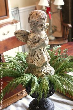 pretty and easy Holiday Centerpiece.  cherub / angel and greenery in a footed bowl.  This would also be perfect for on a Christmas decor mantel.