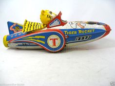 Tiger Rocket   Vintage and Retro Space Age Raygun, Rocket and Robot Toys   Sugary.Sweet Pins   #SpaceAge #Toy #SciFi Vintage Robots, Vintage Toys, Tiger Mask, Rocket Ships, Space Toys, Tin Art, Tin Toys, Retro Toys, Space Age