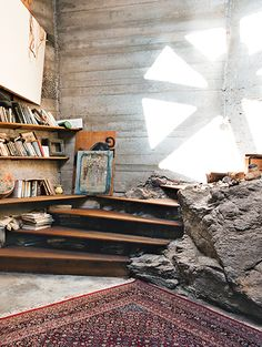Arizona // Rather than dig out a boulder that's part of the mesa Arcosanti rests upon, builders incorporated it into the room.