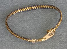 Zipper Bracelet... Cute idea, especially with some added charms.