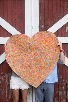 colorful heart photo prop http://www.weddingchicks.com/2013/10/08/anniversary-session/