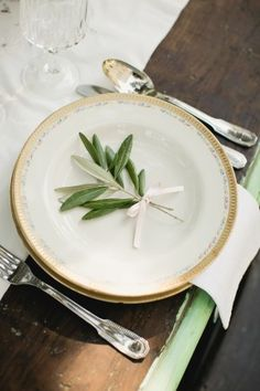 Italian style plate arrangement. This bride used olive leaves to decorate the wedding tables for her guests  #green #table #simple #elegant #italian
