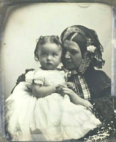 What is mamma whispering in baby's ear? Reassurances, of course! It makes a sweet picture from the 1840s. Baby is so darling and huggable.