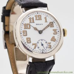 1910's Vintage Rolex Large Sterling Silver watch with White Enamel Dial with Light Beige Luminous Arabic Numbers. Triple Signed. Case Very Good Case Original, Original Bezel, 34mm x 39mm, lug to lug.