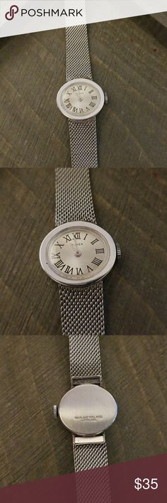 VINTAGE Timex Oval Silver Roman Numeral Watch This Vintage Timex Watch has a Oval Face with Roman Numerals...with a SILVER Belt like strap this is such a cool watch..no signs of wear in perfect condition ....needs a battery.....BIN 4 Timex Accessories Watches