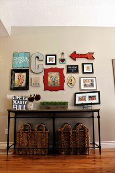 gallery wall idea- table with baskets- red and turquoise-