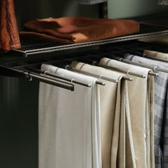 Jeans can be stored folded, or rolled up, while more formal trousers are best hung on extendable pant racks. This separates them for easy selection, keep them wrinkle free and takes up less space than hangers.