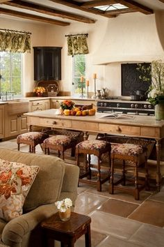 Rustic mediterranean kitchen . Love the large baskets as storage in island and the Floor is gorgeous.
