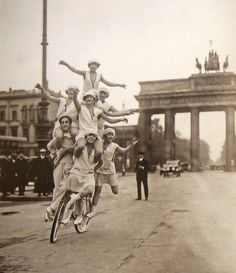dropboxofcuriosities:  In front of the Brandenburg Gate,1920's.