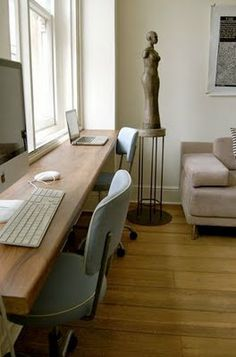 love the simplicity of one long work surface- everyone has laptops- clean lines and the muted colors
