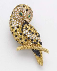 A COLOURED DIAMOND, DIAMOND AND ONYX 'OWL' BROOCH, BY VAN CLEEF & ARPELS - Christie's