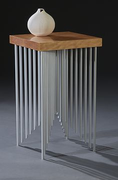 Part furniture and part sculpture, this accent table casts interesting shadows from many angles. Pyramid Side Table by Carol Jackson