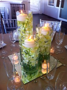 Submerged orchids with tea candles. Can do this with any herb