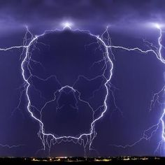 Mirror image of a lightning strike creates a skull in the sky. WoooOOOooo! More