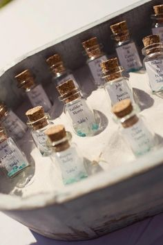 "At my daughter's wedding these were displayed on a table. During cocktail hour guests could find their ""Message In A Bottle"" and locate their table assignment for the reception. The sea glass in each bottle added just the right touch. Love the rustic look of the container, too."