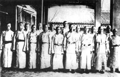 Group photo of imperial eunuchs in the Forbidden City palace.