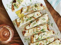 A light layer of creamy ricotta sprinkled with fresh herbs dresses up store-bought crust in this bread starter. Lemon juice and rind add...