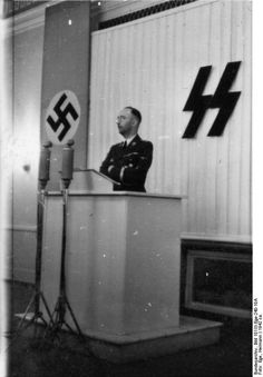 * Heinrich Himmler * am Rednerpult. Schutzstaffel. Himmler was no good speaker, but he was clear - schoolmaster