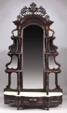 An American Rococo Carved Mahogany Etagere, c., the reticulated crest centered with a strapwork cartouche ca. on Mar 2006 Wardrobe Cabinets, Victorian Furniture, Dresser With Mirror, Bookcases, Rococo, Furniture Decor, Old Things, Auction, Carving