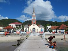 The century Église catholique Saint-Henri at Petite Anse d' Arlet, Martinique, Eastern Caribbean, is perfectly aligned with the communal wharf. David Stanley, 18th Century, Caribbean, Saints, Street View, Catholic
