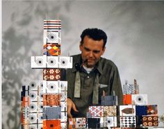 Charles Eames demonstrating his House of Cards game, United States, 1953, photographer unknown.
