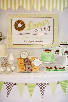 "Vintage doughnut shop party theme, with ""O""-shaped cereal, doughnut-shaped cookies to decorate, and giant ""sprinkles."""