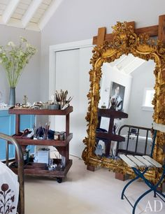 Anh Duong's  East Hampton, New York, house.Duong's studio is appointed with a gilded French mirror; the vase is by Calvin Klein Home.