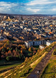 Arthur's Seat view of Edinburgh, Scotland. Arthur's Seat is the main peak of the group of hills in Scotland which form most of Holyrood Park. It is situated in the center of the city of Edinburgh, about a mile to the east of Edinburgh Castle. The hill itself rises above the city to a height of 822 ft., provides excellent panoramic views of the city, is relatively easy to climb, and is popular for hillwalking.