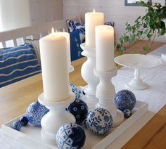 Very pretty display of white candles with blue accents