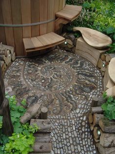 By Paul Herrington http://www.paulherrington.co.uk/Design/Home.html at Chelsea Flower Show 2004, bronze-medal winning Courtyard Garden featuring a wood-fired cedar hot tub, sculptural seating and a pebble mosaic pavement.