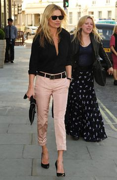 Who says pink is just for blushing flowers? Kate Moss kicks up a pair of blushing trousers with graphic accents for instant chic. Tap into her fierce style with Paul Smith's three-quarter trousers in blush—a perfect summertime staple. Balmain's jacquard blouse adds a dash baroque flair, perfect with Valentino's femme fatale pumps and studded bag for ladylike polish with an urban twist.