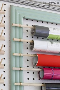 Craft Room Organizational Pegboard Picture frame hooks & dowel rods What a great way to store contact & wrapping papers. The post Craft Room Organizational Pegboard appeared first on Paper Diy. Pegboard Craft Room, Craft Room Storage, Large Pegboard, Pegboard Storage, Organized Craft Rooms, Diy Vinyl Storage, Sewing Room Storage, Pan Storage, Cheap Storage