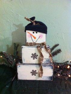 Snowman primitive stacking wood blocks rusty snowflake buttons primitive. $21.99, via Etsy.