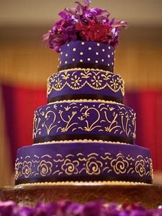Purple and gold Indian wedding cake