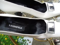 LAGERFELD Stylish courts, with an unusual, slightly twisted high heel, providing stable support with the illusion of lightness, chrome and black accent to vamp, engraved Lagerfeld. Size 41 / 7B /  9 ½