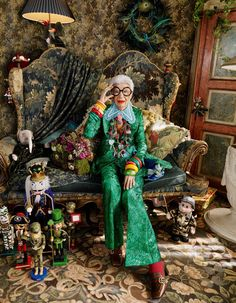 Gucci silk brocade jacket, £1,900, and matching trousers, £835, silk/cotton shirt, £835, embroidered silk tie, £305, and leather shoes, £530. Wolford nylon tights, £25. All accessories, Apfel's own