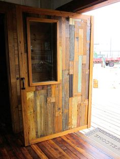 using recycled material for very modern architectural projects. this door( and floor) is beautiful
