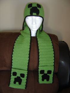Minecraft crochet earflap hat with pocket scarf. Did lots of those for boys. They sure love there minecraft.