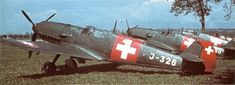 """Line-up of Schweizerische Flugwaffe's Messerschmitt Bf 109E-3s (""""Emil"""") somewhere in Switzerland between Summer 1940 and half-September 1944 (the aircraft has the wartime colors and markings but without the Neutrality bands)."""