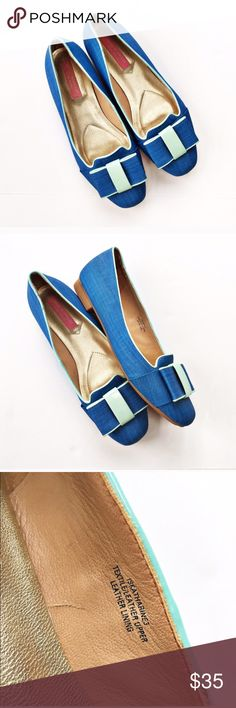 Isaac Mizrahi New York Katherine bow flats Adorable blue flats with bow detail on the toes and contrasting mint piping.. Low heel, leather interior, rubber lower. Size 6 from Isaac Mizrahi New York. Uppers are in perfect condition, soles are mildly stained but have no actual wear. Isaac Mizrahi Shoes Flats & Loafers