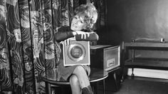 """A less complicated time? Petula Clark holds her 1965 gold record for """"Downtown,"""" an uptempo song in a major key."""
