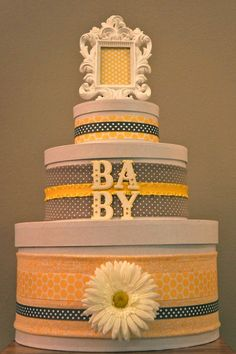 diaper cake.... need to figure out how to make a diaper cake look this good.