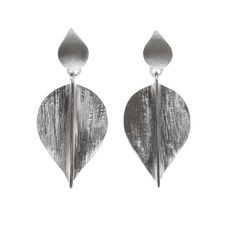 Bodhi Leaf inspired silver earrings, handcrafted by skilled artisans. These earrings offer a touch of glam with a bohemian vibe. You will feel elegant and commanding wearing them.