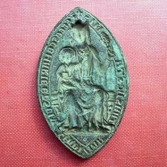 A MEDIEVAL seal matrix found by a man using a metal detector in Cobham has been loaned to a historical society in the West Midlands until the society can raise £8,000 to buy it.    The Stone priory seal matrix, thought to be from the 13th or 14th century, was found on private land in Cobham by Tony Burke and his wife, Veronica.