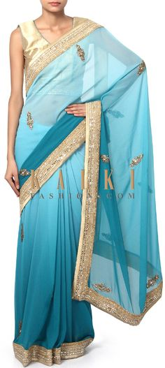 Buy Online from the link below. We ship worldwide (Free Shipping over US$100). Product SKU - 310678.Product Link - http://www.kalkifashion.com/blue-shaded-saree-adorn-in-embellished-butti-only-on-kalki.html