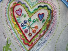 embroidering hearts -- she has many more on the click-through.  imogeneve.blogspot.com.au