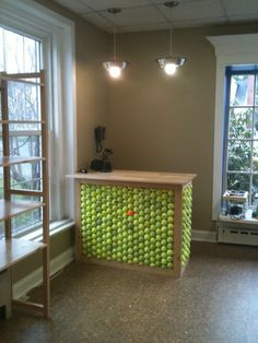 Check out our cash desk and over-head lighting at green dog market! Two of our unused dog bowls make lovely pendant lighting, and repurposed tennis balls are a perfect base for the cash desk.