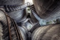 Cavernous: This dizzying image shows a view from the top overlooking multiple flights of concrete stairs